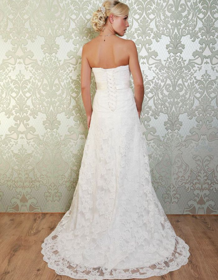 MONTEZ This simple gown is elegant and classy, featuring lace overlay and a narrow skirt that widens into a small, sophisticated train. https://www.wed2b.co.uk/vintage-wedding-dresses/viva-bride-montez.php