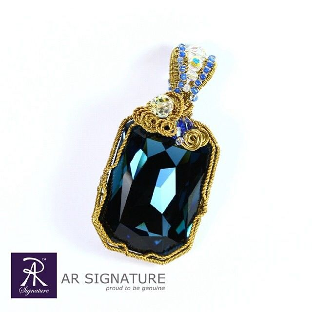AR Signature - The Royal Palace Pendant Colour : Montana 100% handmade using genuine Swarovski Elements  Please visit : www.arsignature.com