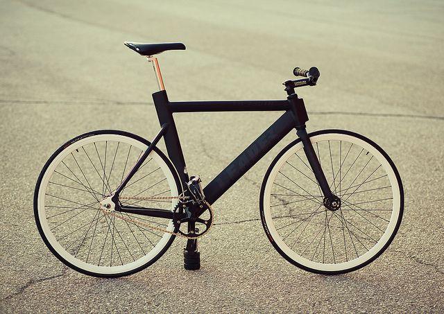 Bike. A design to minimise drag and shorten wheelbase...in a round town bike? funny farm time.