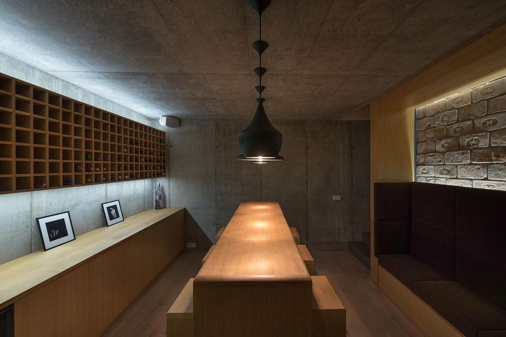 Low light source and dark, heavy materials - intimate space