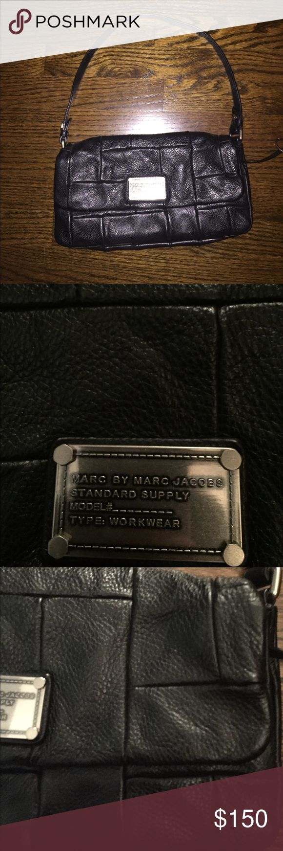 Marc jacobs purse Worn a few times- great condition. Magnetic closure. Black leather with square design. Authentic! Marc by Marc Jacobs Bags