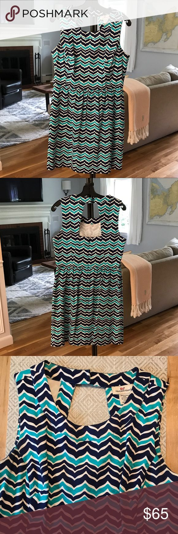 Vineyard Vines Whales Tail Print Dress All over navy and turquoise whales tail print. Flattering fitted upper bodice with a-line skirt. Side hem pockets. Back cutout detail with two button clasp at back of neck. Great condition! Vineyard Vines Dresses