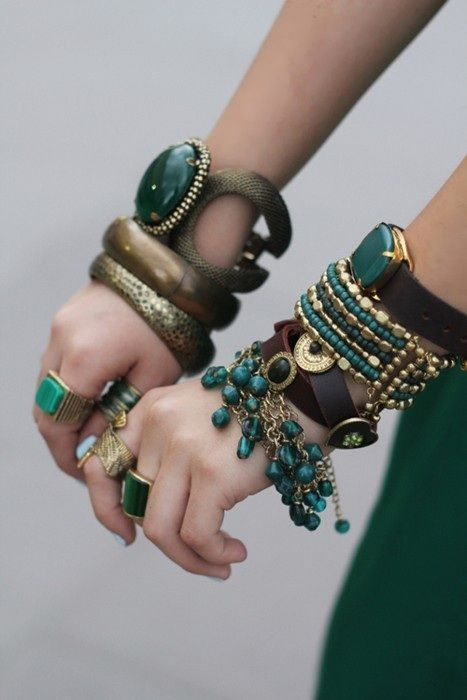 This type of jewelry was hugely influenced by the fashion in Ancient Egypt.  Egyptians were known for their beautifully big accessories with many beads and colors. The gold and turquoise colors are shown a lot for jewelry being worn in Ancient Egypt, and the big stone in the middle of one bracelet, as well as the many beads woven together on another.