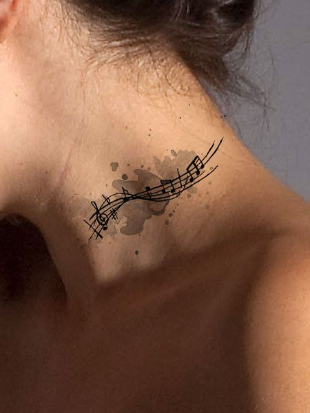 Hum a few bars with this colorful abstract music tattoo that represents energy and a love of music. Available as a black or a color tattoo and looks great as an arm tattoo, neck tattoo, or shoulder or