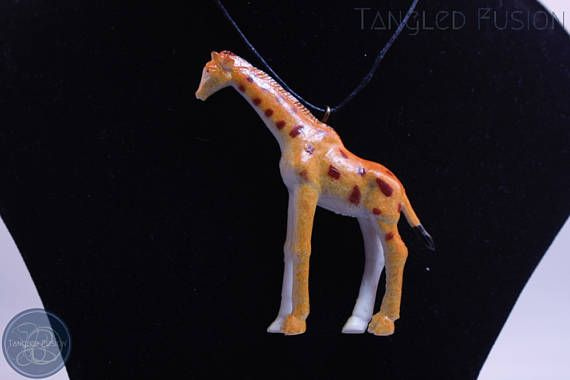 Quirky Handmade Adjustable Animal Necklace on Leather  Design: Giraffe      Tangled Fusion offers a wide scope of quirky, fun jewellery and handmade creations.  https://www.etsy.com/au/listing/524266478/quirky-handmade-adjustable-animal?ref=shop_home_active_5