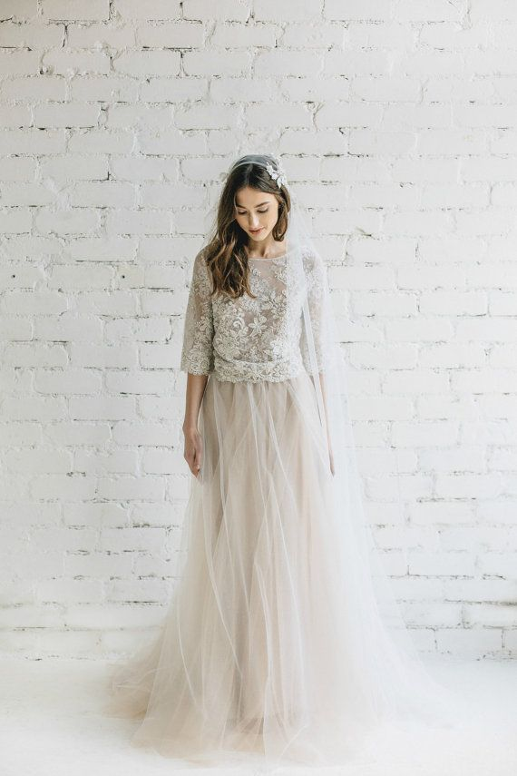 Two Piece Bohemian Wedding Dress - Peony We created matching top for our champagne Peony skirt for bohemian bride to be ! Nude dyed french lace we paired with ivory floral lace and created beautiful bohemian top . Open back finished with buttons. Top could be loose or fitted . Peony skirt wBridal tulle skirt with train features 5 layers of soft hight quality lightweight Italian tulle and 1 layer satin underskirt . This tulle highest possible quality - it is not as stiff as the standard…