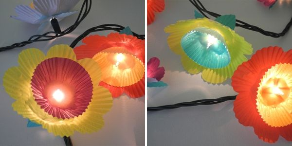 Paper flower lights  Use colored cupcake liners to make these pretty flower lights. Make sure you use LED lights to avoid a fire hazard!
