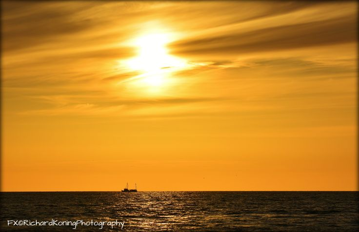 ship in the orange sunset [egmond aan zee]