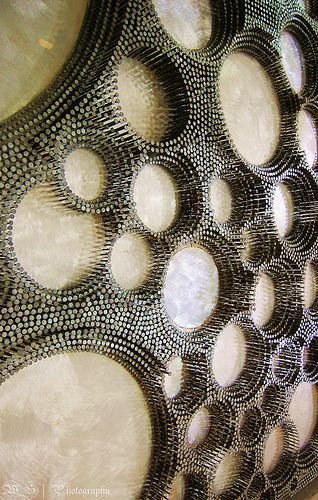 This mosaic is made of nails in wood- I would really love to try something like this smaller scale.