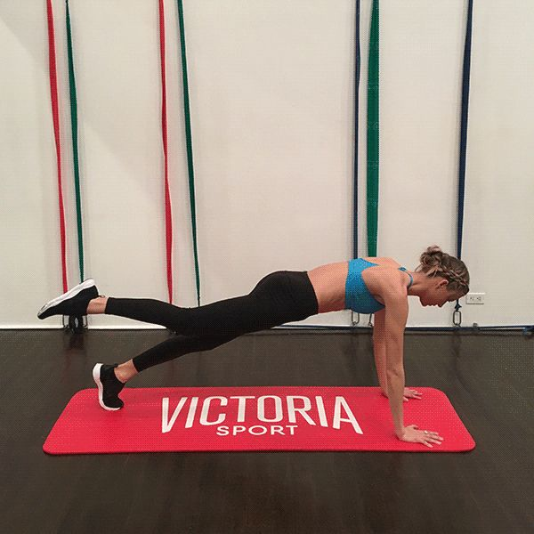 Target abs, legs and booty at once by beginning in a plank position with shoulders down. With abs squeezing tight, bring your right knee into your chest and squeeze, then kick it straight behind you squeezing your glutes with toes pointed also engaging your hamstring