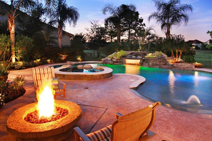 Amazing pool with beach entry built in bar stool fire for Built in pools