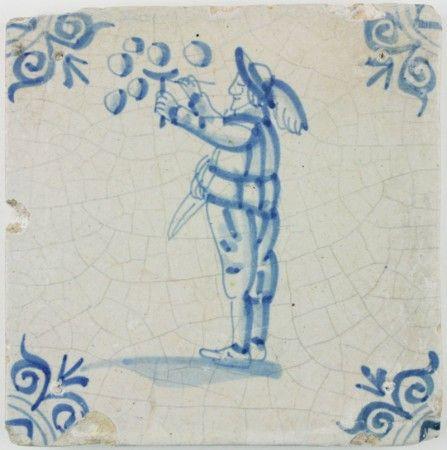 Antique Dutch Delft tile with a boy blowing bubbles, 17th century