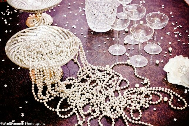 We could place a pile of fun 20s pearls at the front entrance for people to take or place them by a photo area
