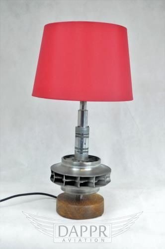 Lamp made from the central turbine section of a Garret Auxiliary Power Unit. The base is turned solid oak.  Made by DappR Aviation