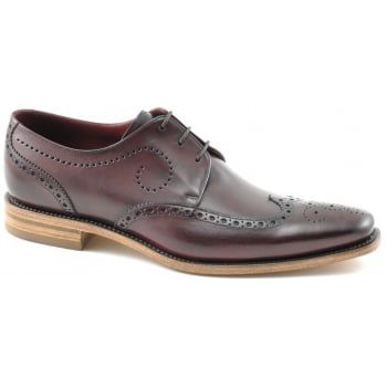 130 years of bench-made shoe-making techniques go into making every pair of these men's Loake Kruger shoes in burgundy burnished calf with scroll and punch pattern. No detail is compromised in this premium range of footwear, using only the finest calf leathers and featuring Goodyear Welting on the leather soles. http://www.marshallshoes.co.uk/mens-c1/formal-c4/loake-mens-kruger-burgundy-calf-leather-punched-derby-brogue-shoe-p4420