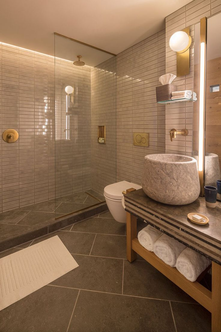 in this modern hotel bathroom tiles cover the walls while in the shower hidden - Fantastisch Bing Steam Shower
