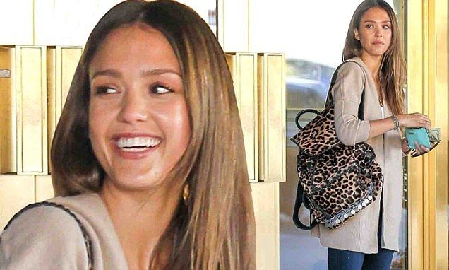 Casual Jessica Alba shows her wild side with leopard print backpack