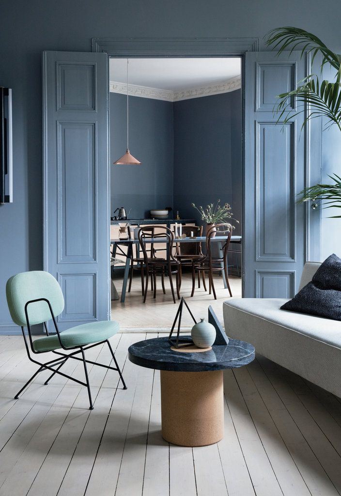 In Alessandro D'Orazio and Jannicke Krakvik's living room at home in Oslo, a mix of Italian and Scandinavian furniture reflects their distinct backgrounds. (He is Italian, she is Norwegian.)