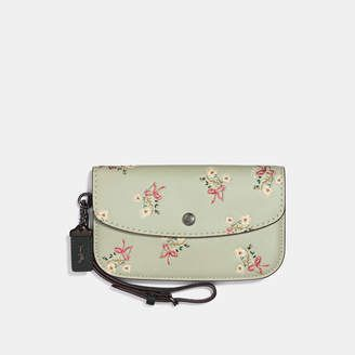 heeey I could go for this Coach Clutch With Floral Bow Print #coach #clutch #afflink