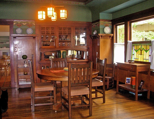 Craftsman home dining room. Look at the gorgeous built in cabinet and beautiful window.