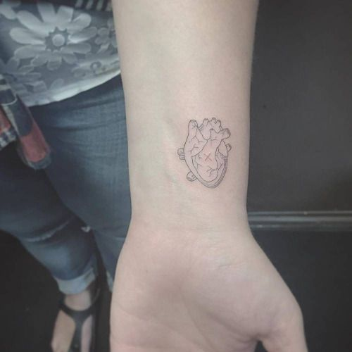 Fine line style heart tattoo on the left inner wrist. Tattoo...