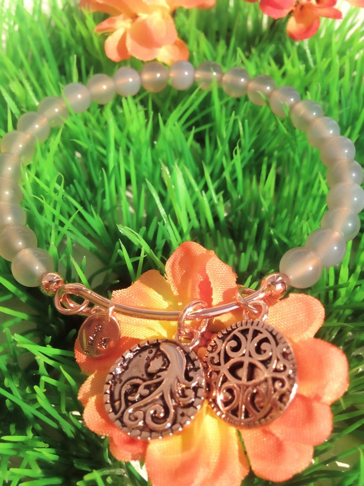 Grey Quartz bangle with rose gold charms to celebrate femininity and womanhood available now on www.aistikas.com WE ALL NEED ONE GIRLS!