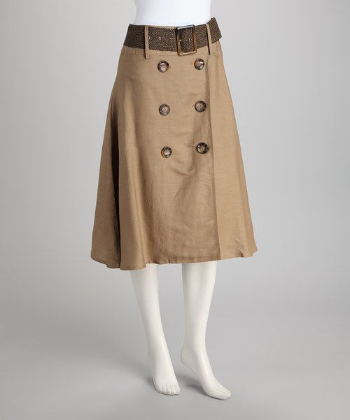 This double-breasted skirt maintains a professional façade while a belt adds a trendy yet tailored look.Includes skirt and beltMeasurements (size 6): 29'' longBody: 55% ramie / 45% rayonLining: 100% polyesterHand wash; hang dry