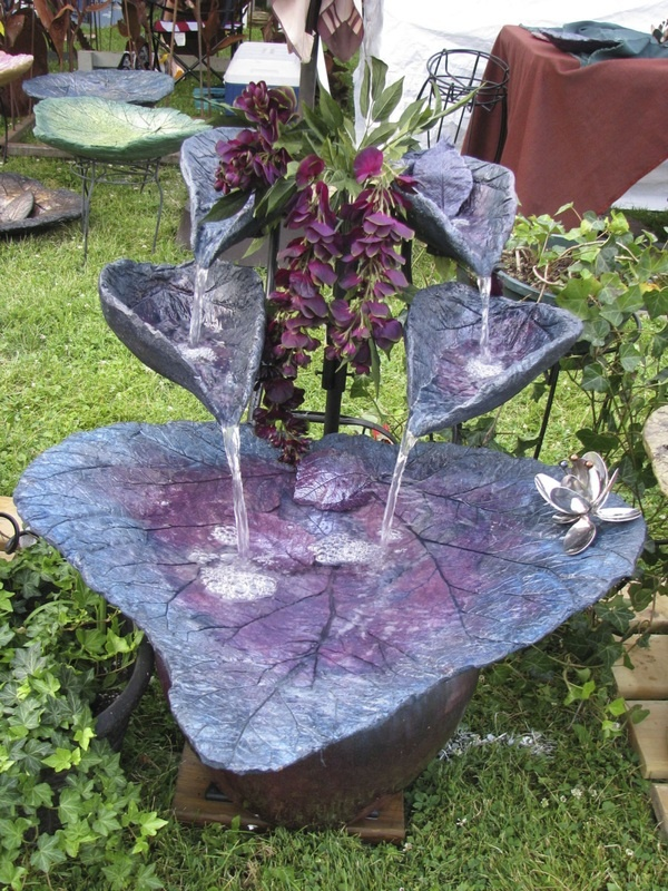 I saw these at the Spring Green Art Fair.  The pics do not do them justice.  These fountains are beautiful!  Fountains by Artistic Solutions, Beloit, WI.