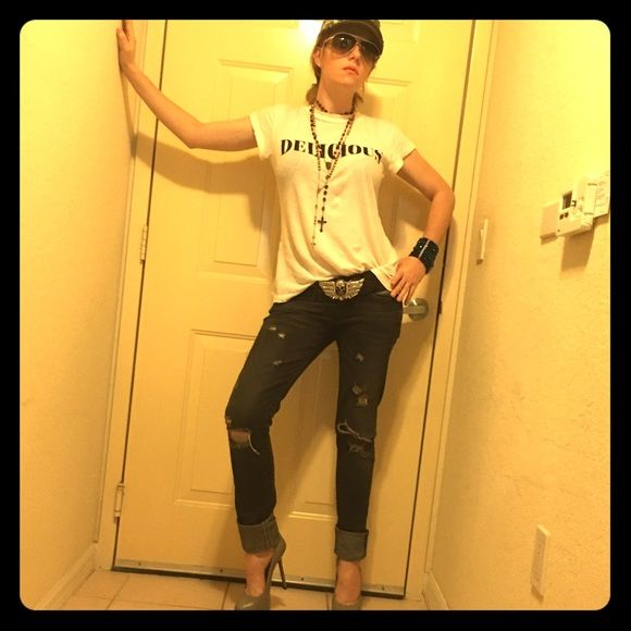 True Religion Distressed *JULIE* Skinny Jeans. These awesome true religion Julie style jeans are great if you are a jean  whore like myself. Yes I did just say that. I like to think of myself as my own rockstar so I love the holes and the Motley black/gray color of these jeans. The back right button does have a little of the black chipped but you cannot notice when wearing. These are size 25!!!! Please see pics!!!  True Religion Jeans Skinny