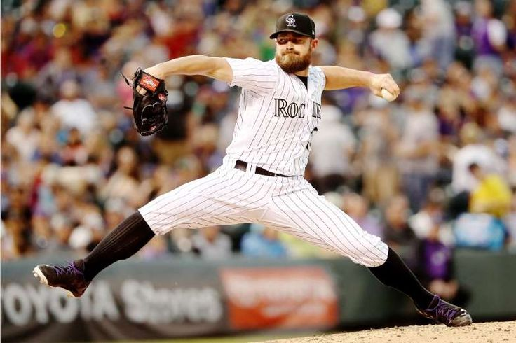 LONG STRIDE:    Mike Dunn of the Colorado Rockies pitches against the Arizona Diamondbacks at Coors Field in Denver on May 7.