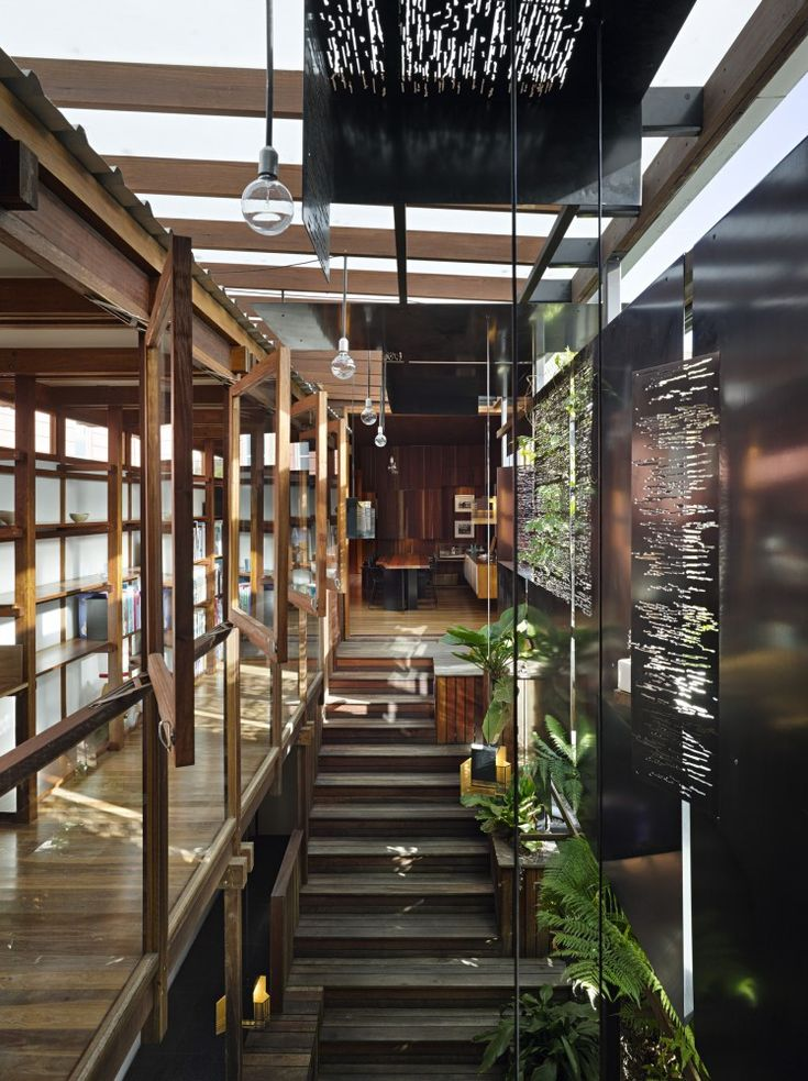 """The Left-Over-Space House / Cox Rayner Architects At only 3 meters wide, the Left-Over-Space house occupies the """"left-over"""" space within the city. What was originally a tiny caretakers cottage is recycled and expanded into a a linear house."""
