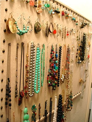 Use an old bulletin board to store jewelry...a great reminder of what I have, too!