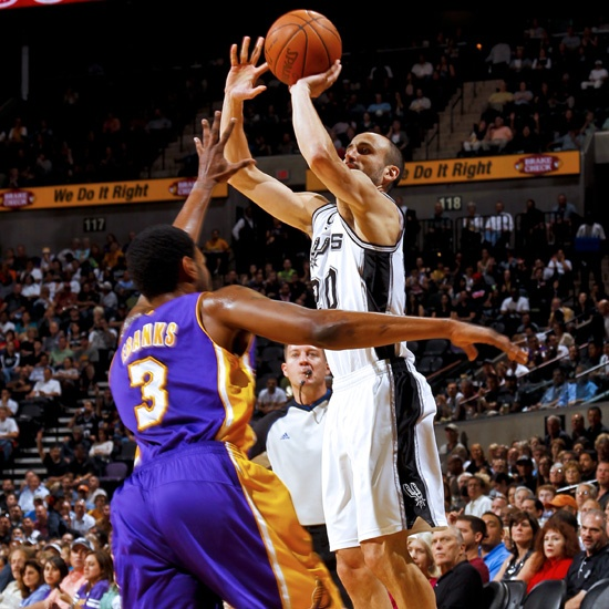 The Spurs' Manu Ginobili puts up a jumper over Devin Ebanks during Wednesday's game.