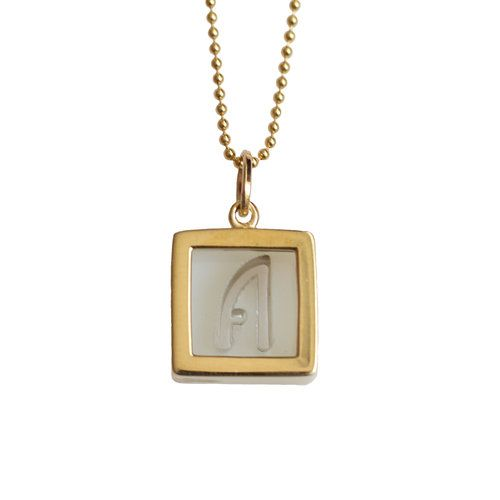 Designed and handmade in Portland, USA. This original Be The Good Glass Box Monogram is cast in long-lasting timeless bronze with a warm gold hue and encases a fire glazed glass initial.  Hangs on a 24-inch 14 K gold vermeil ball chain. Each Monogram charm has a large bail to allow for adding or interchanging a variety of chains and charms. For each Glass Box Monogram purchased, Be The Good donates an accessory to the not-for-profit Dress For Success.