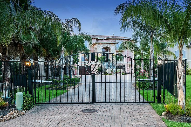 Stately Mediterranean Luxury Home with Electronic Gates. Water Feature at base of stairs.  Paved drives, ample parking and 4/5 car garage with extra storage.