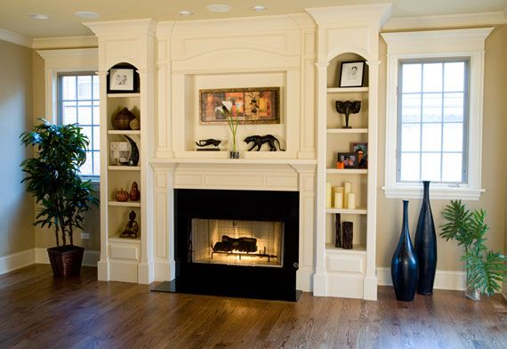 white fireplace with built-ins