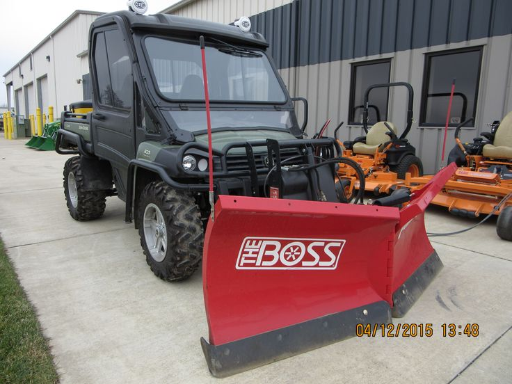 John Deere Gator 825i with red BOSS snowplow