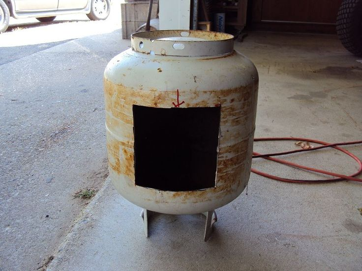 Cheaper wood burning stove option for a sauna. Used 20gal propane tank.