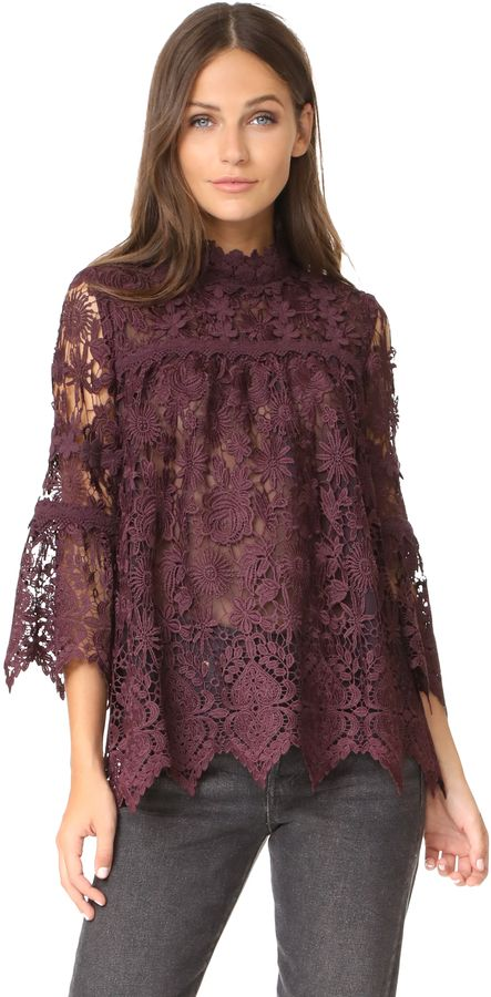 Anna Sui Romantique Lace Top :-A delicate lace Anna Sui blouse with a floral pattern. High neckline and 3/4 bell sleeves.