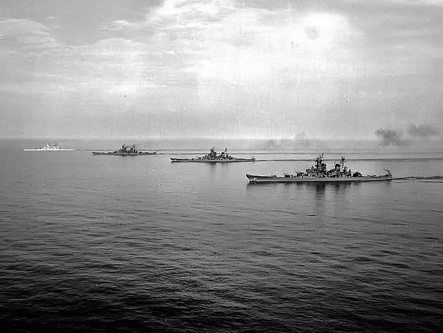 All four Iowa-class battleships steaming together (1954). Ship closest to the camera is USS Iowa (BB-61). The others are (from near to far): USS Wisconsin (BB-64); USS Missouri (BB-63) and   USS New Jersey (BB-62).