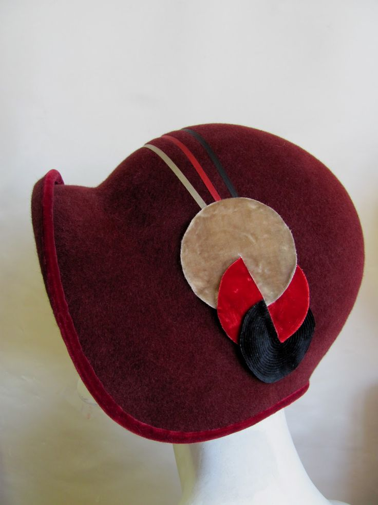 Phryne's hat from Miss Fisher's Murder Mysteries - gorgeous velvet art deco detail - same on the other side, but the three ribbons enter the beige circle at the same point instead of spread out as this side does.