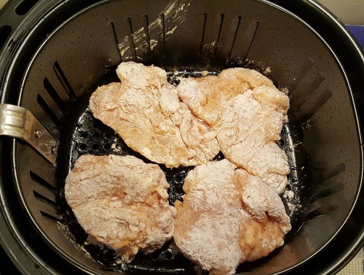 Place Chicken Pieces into Prepared Air Fryer Image