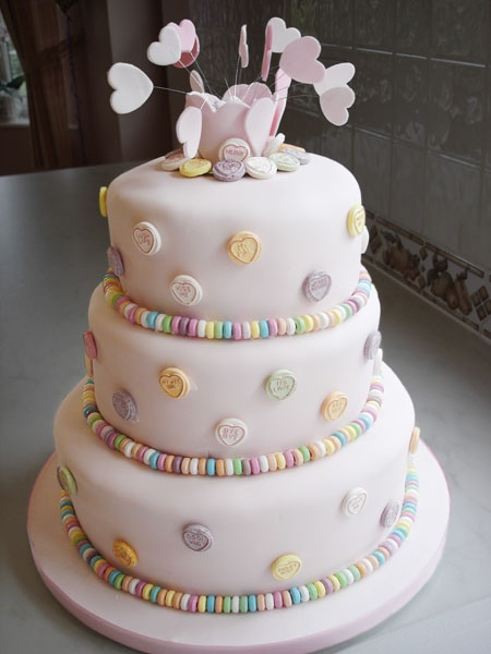 Love hearts wedding cake, we had a heart shaped wedding cake with lilac love hearts on.