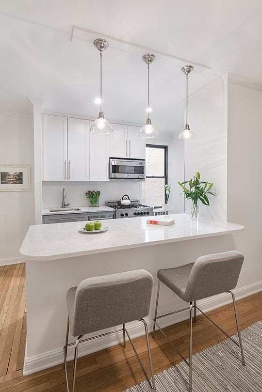 Before & After: A NYC Galley Kitchen Opens Up | Apartment Therapy | Benjamin Moore (upper cabinets-White Heron...lower cabinets-Gull Wing Gray)   Quartz, instead of Marble, from LG.