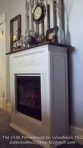 how to upgrade your electric fireplace heater on the cheap, fireplaces mantels, heating cooling, Heat Surge Heater AFTER