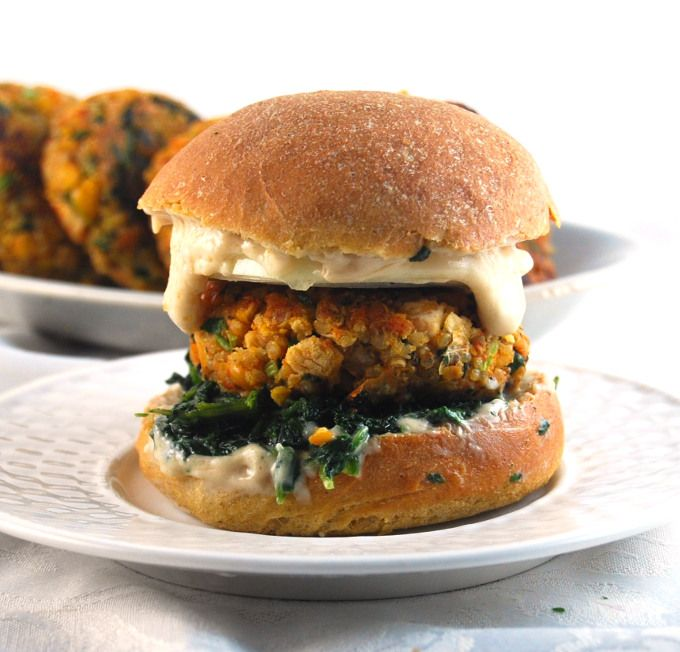 Hearty Chickpea Quinoa Burgers with Sauteed Greens -- comes together in minutes and is made from pantry ingredients. | Very tasty. The patties are also very good in pitas with lettuce the next day.
