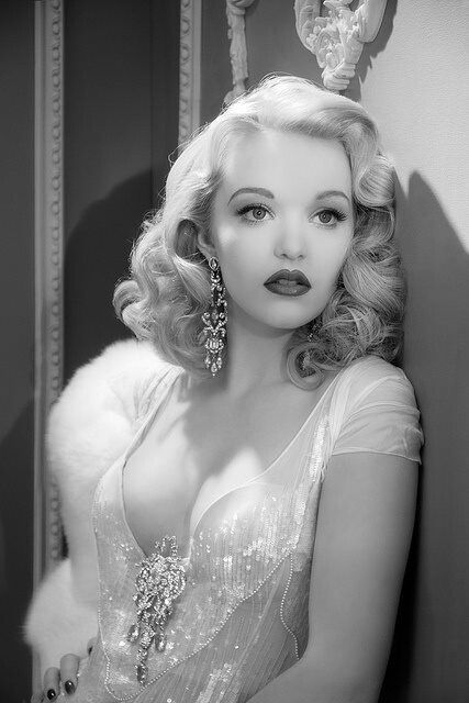 Old Hollywood Hair and Make-up; could be a military ball. None-the-less, I love her hairstyle~ the soft curls.