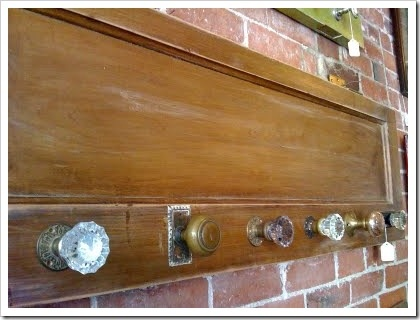 A collection of vintage door knobs lined in a row is would make a fun and eclectic towel hook bar.