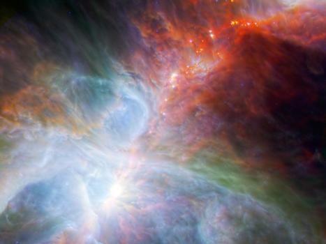 Die kombinierte Aufnahme der Weltraumteleskope Herschel und Spitzer zeigt wie auf einer Perlenkette Sterne im Orionnebel, die in der Entstehung begriffen sind