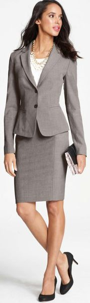Business professional suit option for women. Interview attire: matching suit, close-toed shoes, relatively conservative jewelry, conservative top.